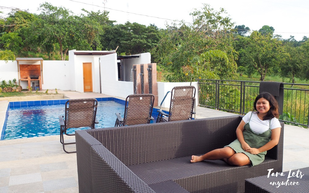 Kat lounging in poolside at Tyvo Resort