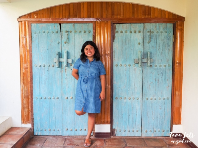 Kat in blue door in Ataalaya Farmhouse