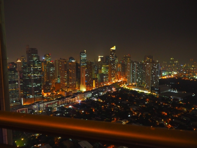 ZenRooms Gramercy Residences - balcony view at night